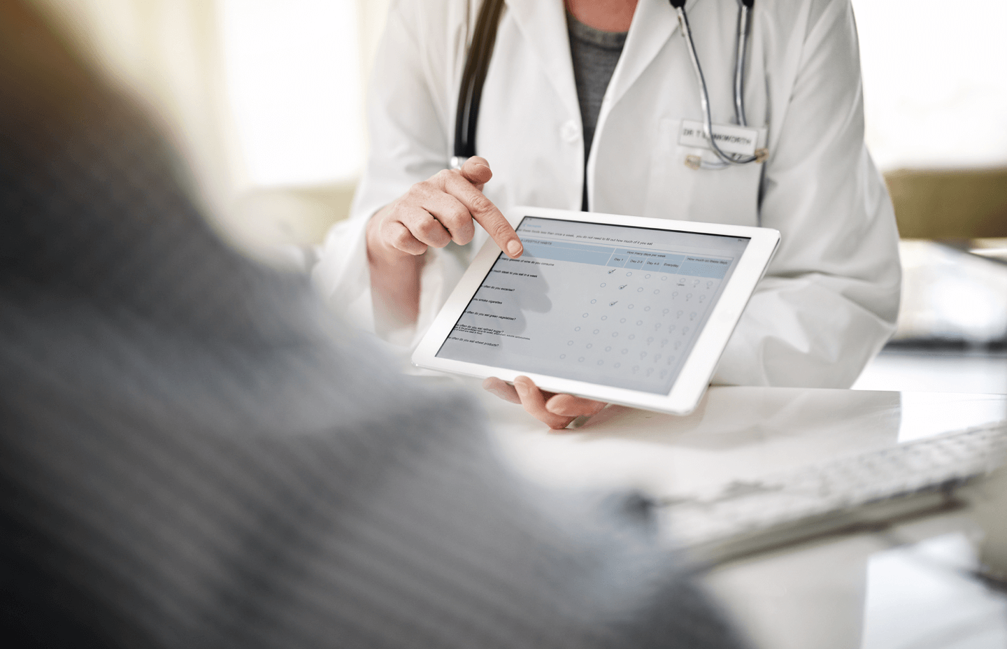 Doctor holding device with online patient intake form
