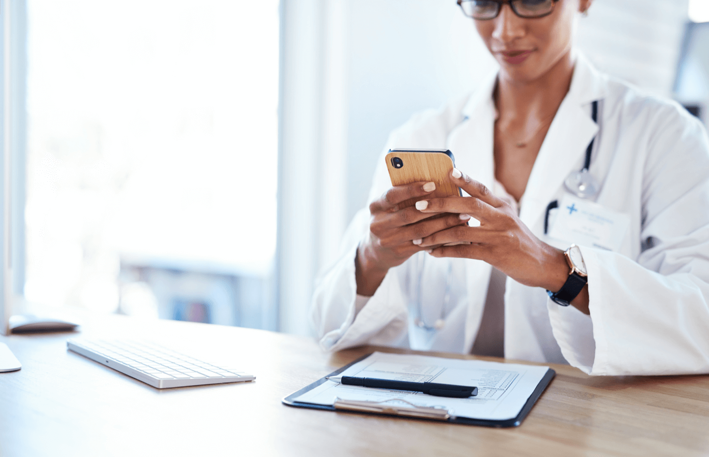 Clinic doctor texting patient back