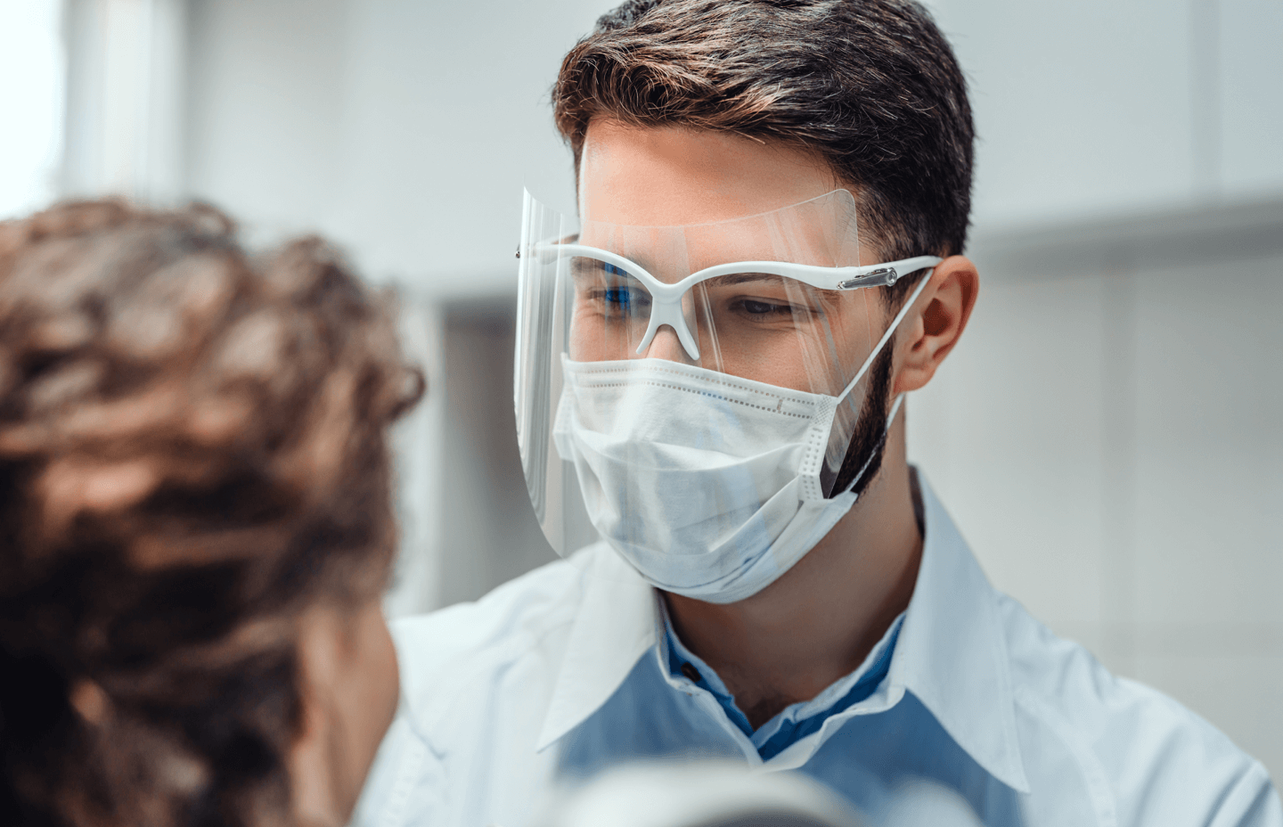 Doctor screening patient wearing face mask